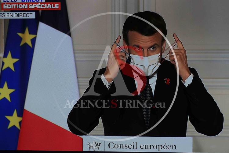 Coronavirus Pandemic - French President Emmanuel Macron address  in Paris, France on March 25, 2021. BFM TV Screen showing French President Emmanuel Macron address after the EU Summit
