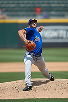 Durham Bulls relief pitcher Colin Poche (32) in action against the Charlotte Knights at BB&T BallPark on May 27, 2019 in Charlotte, North Carolina. The Bulls defeated the Knights 10-0. (Brian Westerholt/Four Seam Images)