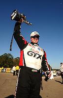 Mar. 13, 2011; Gainesville, FL, USA; NHRA funny car driver Mike Neff celebrates after winning the Gatornationals at Gainesville Raceway. Mandatory Credit: Mark J. Rebilas-.