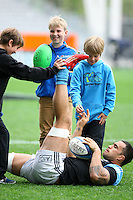 All Black Liam Messam with fans at the captains run prior to the Rugby Championship, Bledisloe Cup test match between New Zealand and Australia, Forsyth Barr Stadium, Dunedin, New Zealand, Friday, October 18, 2013. Photo: Dianne Manson / photosport.co.nz