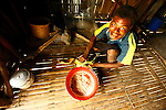 """Children preparing in this local habitation a sago bread (mix of sago and coconuts with water) in the village of Hessessai Bay at PanaTinai (Panatinane)island in the Louisiade Archipelago in Milne Bay Province, Papua New Guinea.  The island has an area of 78 km2..Sago is a starch extracted from the pith of sago palm stems, Metroxylon sagu. It is a major staple food for the lowland peoples of New Guinea and the Moluccas, where it is called saksak and sagu. It is traditionally cooked and eaten in various forms, such as rolled into balls, mixed with boiling water to form a paste, or as a pancake..Sago looks like many other starches, and both sago and tapioca are produced commercially in the form of """"pearls"""". Sago pearls are similar in appearance to tapioca pearls, and the two may be used interchangeably in some dishes. This similarity causes some confusion in the names of dishes made with the pearls..The Louisiade Archipelago is a string of ten larger volcanic islands frequently fringed by coral reefs, and 90 smaller coral islands located 200 km southeast of New Guinea, stretching over more than 160 km and spread over an ocean area of 26,000 km? between the Solomon Sea to the north and the Coral Sea to the south. The aggregate land area of the islands is about 1,790 km? (690 square miles), with Vanatinai (formerly Sudest or Tagula as named by European claimants on Western maps) being the largest..Sideia Island and Basilaki Island lie closest to New Guinea, while Misima, Vanatinai, and Rossel islands lie further east..The archipelago is divided into the Local Level Government (LLG) areas Louisiade Rural (western part, with Misima), and Yaleyamba (western part, with Rossell and Tagula islands. The LLG areas are part of Samarai-Murua District district of Milne Bay. The seat of the Louisiade Rural LLG is Bwagaoia on Misima Island, the population center of the archipelago.PanaTinai (Panatinane) is an island in the Louisiade Archipelago in Milne Bay Province, Papua New Guine"""