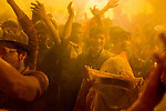 Devotees play with gulal(dry colured powder) on the occasion of Holi Festival at Vrindavan. Holi - The  Hindu festival of colour is celibrated for a week in the Brraj region of Uttar Pradesh, India.