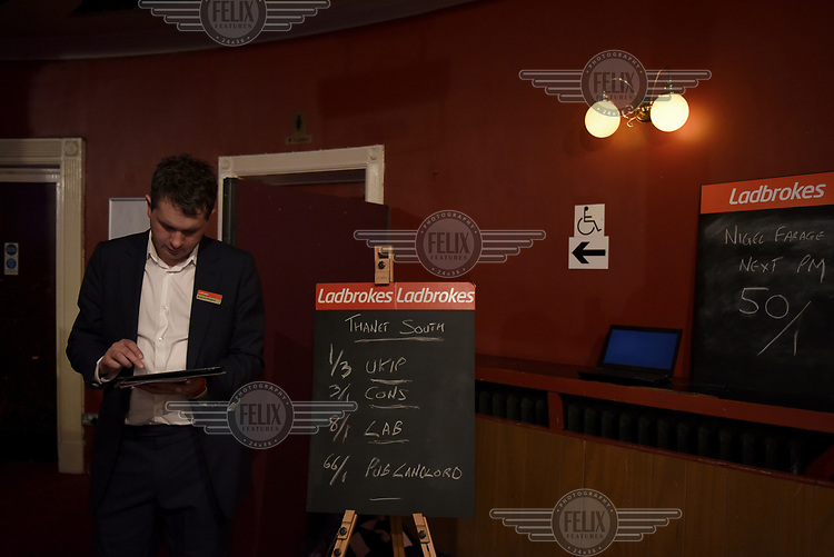 The local constituency election odds and the odds for Nigel Farage to be the Prime Minister written up on blackboards at the UKIP Spring Conference at the Winter Gardens theatre during campaigning for the 7 May 2015 general election.