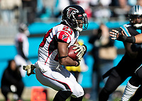 CHARLOTTE, NC - NOVEMBER 17: Brian Hill #23 of the Atlanta Falcons makes a run during a game between Atlanta Falcons and Carolina Panthers at Bank of America Stadium on November 17, 2019 in Charlotte, North Carolina.