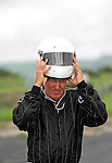 Peter Hain MP, the Secetary of State for Wales dons a crash helmet as he climbs into a race car to officially launch Swansea Metropolitan University's new BSc (Hons) degree in Motorsport Technology at the Pembrey Motor Circuit in Llanelli today. Mr Hain took to the wheel of one the University's fleet of motorsport vehicles and drove a couple of laps at high speed around the circuit..