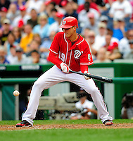 5 July 2009: Washington Nationals' starting pitcher Scott Olsen lays down a bunt against the Atlanta Braves at Nationals Park in Washington, DC. Olsen came within one out of his first career complete game as he helped the Nationals defeat the Braves 5-3 to take the rubber game of their 3-game weekend series. Mandatory Credit: Ed Wolfstein Photo