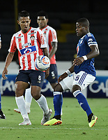 BOGOTA - COLOMBIA, 09-09-2018: Andres Felipe Roman (Der) jugador de Millonarios disputa el balón con James Sanchez Altamiranda (Izq) jugador de Atlético Junior durante partido por la fecha 9 de la Liga Águila II 2018 jugado en el estadio Nemesio Camacho El Campin de la ciudad de Bogotá. / Andres Felipe Roman (R) player of Millonarios fights for the ball with James Sanchez Altamiranda (L) player of Atletico Junior during the match for the date 9 of the Liga Aguila II 2018 played at the Nemesio Camacho El Campin Stadium in Bogota city. Photo: VizzorImage / Gabriel Aponte / Staff.