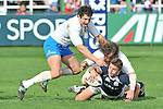 Scotland's Chris Cusiter is tackled by Martin Castrogiovanni and Alessandro Zanni (left) of Italy during the RBS 6 Nations Rugby match between Italy and Scotland at the Flaminio Stadium in Rome on February 27, 2010.
