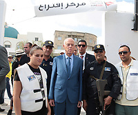 Kais Saied, an independent law professor and presidential candidate (R), queues at a polling station in the capital Tunis on October 6, 2019, during the third round of legislative elections