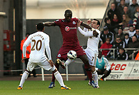 Pictured: Swansea's Leon Britton with an unorthodox tackle on Moussa Sissoko<br /> Saturday 2nd March 2013<br /> Re: Barclays Premier League, Swansea City V Newcastle United, Liberty Stadium.