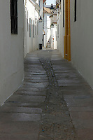 View of a cobbled alley in the Juderia Quarter, Cordoba, Andalusia, Spain.
