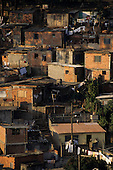Sao Paulo, Brazil. Shanty town houses (shacks), mostly brick, some wooden, one rendered and painted with security grilles.