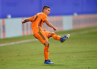 LAKE BUENA VISTA, FL - JULY 18: Tomás Martínez #10 of the Houston Dynamo watches his pass during a game between Houston Dynamo and Portland Timbers at ESPN Wide World of Sports on July 18, 2020 in Lake Buena Vista, Florida.