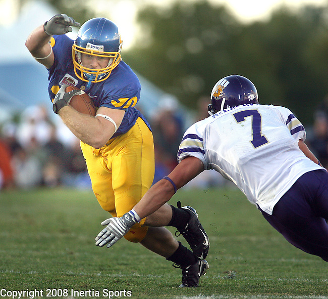 BROOKINGS SD -- SEPTEMBER 13 -- Kyle Minett #30 of South Dakota State tries to get past Mike McEachern #7 of Western Illinois during their game Saturday evening at Coughlin Alumni Stadium in Brookings, S.D.  (Photo by Dick Carlson/Inertia)