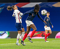 LE HAVRE, FRANCE - APRIL 13: Alex Morgan #13 of the USWNT fights for the ball with Aissatou Tounkara #5 of France during a game between France and USWNT at Stade Oceane on April 13, 2021 in Le Havre, France.