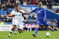 Danny Ward of Cardiff City has a shot on goal under pressure fromJames Meredith of Millwall during the Sky Bet Championship match between Cardiff City and Millwall at The Cardiff City, Cardiff, Wales, UK. Saturday 28 October 2017