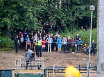 16.08.2020 Livingston v Rangers: Rangers fans watching the game from a nearby hill