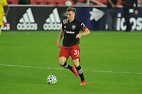 WASHINGTON, DC - OCTOBER 28: Julian Gressel #31 of D.C. United moves the ball during a game between Columbus Crew and D.C. United at Audi Field on October 28, 2020 in Washington, DC.
