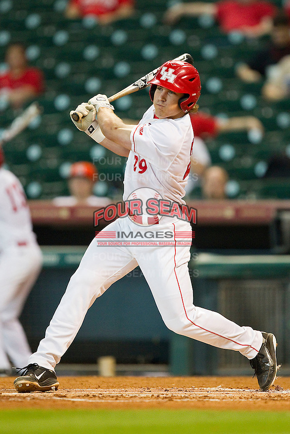 Zack Gibson #29 of the Houston Cougars follows through on his swing against the Tennessee Volunteers at Minute Maid Park on March 2, 2012 in Houston, Texas.  The Cougars defeated the Volunteers 7-4.  (Brian Westerholt/Four Seam Images)