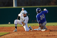 Second baseman Daniel Seeba (5) of the University of South Carolina Upstate Spartans can't catch the throw from home as Robert McIntosh (24) of the UNC Asheville Bulldogs steals second on Tuesday, March, 25, 2014, at Cleveland S. Harley Park in Spartanburg, South Carolina. (Tom Priddy/Four Seam Images)