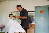Boy receiving a haircut at a barbershop in Vinales, Pinar del Rio Province, Cuba.