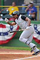 Yasiel Balaguert #22 of the Kane County Cougars runs to first base against the Clinton LumberKings at Ashford University Field on July 6, 2014 in Clinton, Iowa. The LumberKings won 1-0.   (Dennis Hubbard/Four Seam Images)