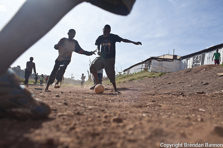 """Charities are businesses; They have to show kids playing in shit to get money. Do you see any kids playing in shit here?"" asked Octopizzo as we passed a fgroup of kids playing soccer."