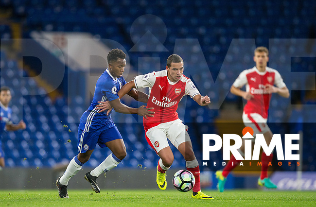 Ismael Bennacer of Arsenal holds off Josemar Quintero of Chelsea during the EPL2 - U23 - Premier League 2 match between Chelsea and Arsenal at Stamford Bridge, London, England on 23 September 2016. Photo by Andy Rowland.