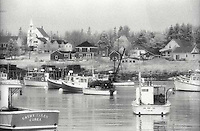 Fishing boats moored in picturesque harbor<br />