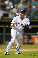 Round Rock Express pitcher Scott Richmond (55) bobbles a ground ball during the Pacific Coast League baseball game against the New Orleans Zephyrs on June 30, 2013 at the Dell Diamond in Round Rock, Texas. Round Rock defeated New Orleans 5-1. (Andrew Woolley/Four Seam Images)