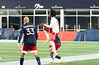 FOXBOROUGH, MA - OCTOBER 16: Ronaldo Damus #11 of North Texas SC leaps for a high ball during a game between North Texas SC and New England Revolution II at Gillette Stadium on October 16, 2020 in Foxborough, Massachusetts.