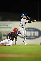 Hudson Valley Renegades shortstop Bill Pujols (3) throws to first as Isaiah White (18) slides in during a game against the Batavia Muckdogs on August 1, 2016 at Dwyer Stadium in Batavia, New York.  Hudson Valley defeated Batavia 5-1.  (Mike Janes/Four Seam Images)