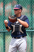 GCL Braves catcher Chad Comer #20 warms up a pitcher in the bullpen during a game against the GCL Pirates at Disney Wide World of Sports on June 25, 2011 in Kissimmee, Florida.  The Pirates defeated the Braves 5-4 in ten innings.  (Mike Janes/Four Seam Images)