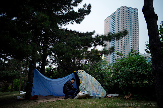 Tunisian immigrants who left Tunisia after the revolution are living rough in a park on the outer edge of Paris, France on April 28, 2011. The migrants arrived on the Italian island of Lampedusa by boat and have headed north in search of jobs.