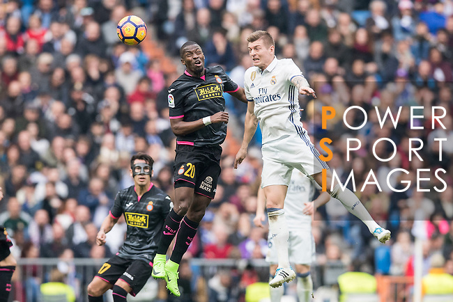 Toni Kroos of Real Madrid and Papakouli Diop of RCD Espanyol  compete for the ball during the match Real Madrid vs RCD Espanyol, a La Liga match at the Santiago Bernabeu Stadium on 18 February 2017 in Madrid, Spain. Photo by Diego Gonzalez Souto / Power Sport Images