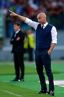 Calcio, Serie A: Roma vs ChievoVerona. Roma, stadio Olimpico, 18 ottobre 2014.<br /> ChievoVerona's coach Eugenio Corini gestures to his players during the Italian Serie A football match between Roma and ChievoVerona at Rome's Olympic stadium, 18 October 2014.<br /> UPDATE IMAGES PRESS/Isabella Bonotto