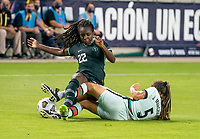 HOUSTON, TX - JUNE 13: Sunday Etim #22 of Nigeria is tackled by Joana Marchao #5 of Portugal during a game between Nigeria and Portugal at BBVA Stadium on June 13, 2021 in Houston, Texas.