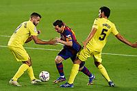 27th September 2020; Camp Nou, Barcelona, Catalonia, Spain; La Liga Football, Barcelona versus Villareal; Leo Messi skips between the challenge from from Parejo and Mario Gaspar of Villareal