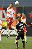 D. C. United defender Bryan Namoff (26) watches as New York Red Bulls forward Juan Pablo Angel (9) heads the ball. The New York Red Bulls defeated D. C. United 4-1 during a Major League Soccer match at Giants Stadium in East Rutherford, NJ, on August 10, 2008.