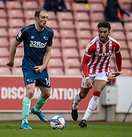 20th March 2021; Bet365 Stadium, Stoke, Staffordshire, England; English Football League Championship Football, Stoke City versus Derby County; Matt Clarke of Derby County looks to pass the ball across field