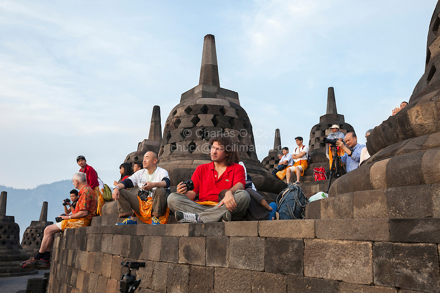 Borobudur, Java, Indonesia. Tourists at top of Temple Waiting for Morning Sunrise.