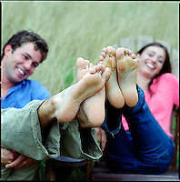 Couple, seated, with feet in the air<br />
