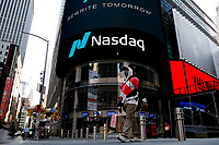 NEW YORK, NEW YORK - MARCH 10: A man walks in front Nasdaq building at Times Square on March 10, 2021, in New York. The Nasdaq Composite continued falling more than half a percent during the day also the move away from Apple Inc, Amazon.com Inc , Facebook Inc, Tesla Inc and Microsoft Corp, falling during the day, helped small-cap stocks rise more than double the gains of the S&P 500. (Photo by John Smith/VIEWpress)
