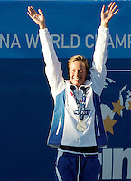 Italy's Federica Pellegrini celebrates on the podium after winning the gold medal and setting the new world record clocking 1.52.98 in the Women's 200m Freestyle, at the Swimming World Championships in Rome, 29 July 2009..UPDATE IMAGES PRESS/Riccardo De Luca