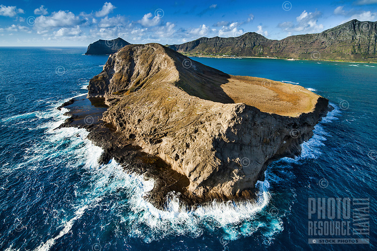 An aerial view of Rabbit Island, (a.k.a. Manana Island) at sunrise, with the Makapu'u Lighthouse in the far distance, O'ahu.