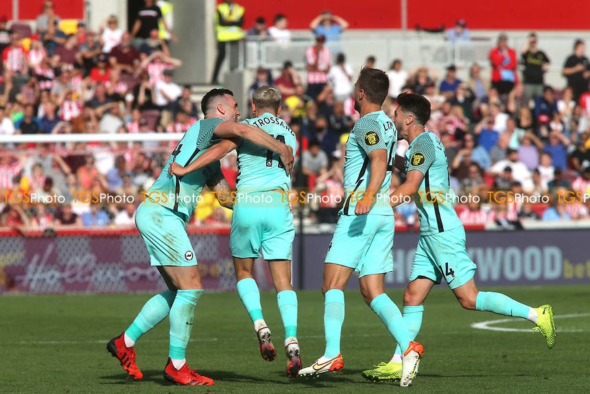 Leandro Trossard of Brighton & Hove Albion celebrates scoring their only goal of the match with Shane Duffy during Brentford vs Brighton & Hove Albion, Premier League Football at the Brentford Community Stadium on 11th September 2021