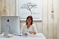 Portrait of Cara Connell in her office, which was custom-built by London Garden Studios
