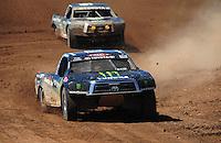 Apr 16, 2011; Surprise, AZ USA; LOORRS driver Johnny Greaves (16) leads Rick Huseman (36) during round 3 at Speedworld Off Road Park. Mandatory Credit: Mark J. Rebilas-.