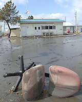 110312-N-ZI955-085<br /> HACHINOHE, Japan (March 12, 2011) A desk chair lies in a layer of mud and petroleum that now covers much of the U.S. Navy Fleet and Industrial Supply Center facility Yokosuka Defense Fuel Support Point, Hachinohe after a tsunami swept through the area. The tsunami was triggered by an 8.9 magnitude earthquake, the strongest ever recorded in Japan, which caused considerable damage to the country's eastern coastline. (U.S. Navy photo by Chief Mass Communication Specialist Daniel Sanford/Released)