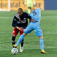 FOXBOROUGH, MA - SEPTEMBER 02: Teal Bunbury #10 of New England Revolution and Anton Tinnerholm #3 of New York City FC battle for the ball during a game between New York City FC and New England Revolution at Gillette Stadium on September 02, 2020 in Foxborough, Massachusetts.